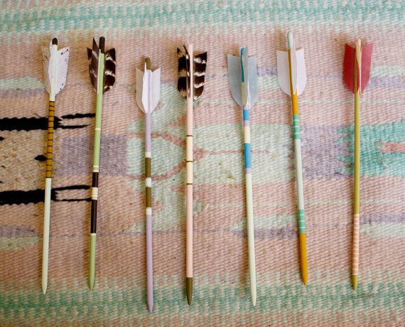 Hair pin arrows. ;D I could probably make these. lol with wooden dowels, paint, painters tape, and feathers. :3