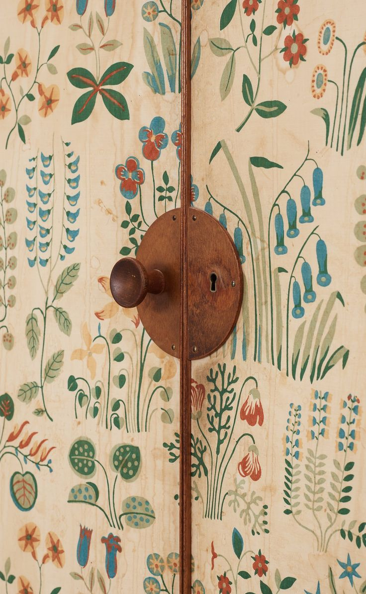 Josef Frank doors and sides covered in Frank's floral chintz fabric 'Fatima'