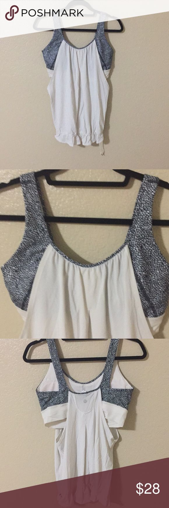 Lululemon Tank size 10 Adorable white slouchy tank with side cut outs and blue flower bra (with pads). size 10. Has a cinch bottom to keep in place for your workout lululemon athletica Tops Tank Tops