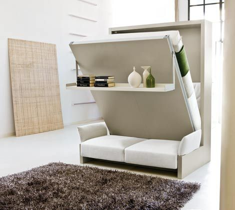 The Nuovoliola '10  Space Saving System consists of a Queen wall bed with a comfortable sofa with or without arms on the front. There is additional storage underneath the sofa seat. Without removing any objects from the shelf, a simple pull on the built-in handle lowers the bed to the sleeping position and the shelf becomes the foot of the bed.  This is a self standing model.