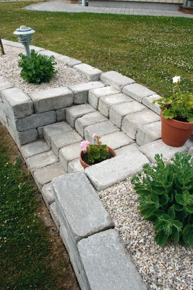 handling a slope (grade change) with a retaining wall w/ french drain, planting area & steps -- adding a water feature (waterfall) would raise this to star status