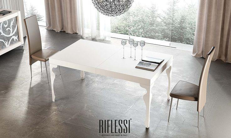 The luxurious soul of this extensible table is enclosed in its elegant, contoured legs, embellished with chromed steel or RAL paint finish.The white lacquered or white stained oak top is available on request in many other finishes.