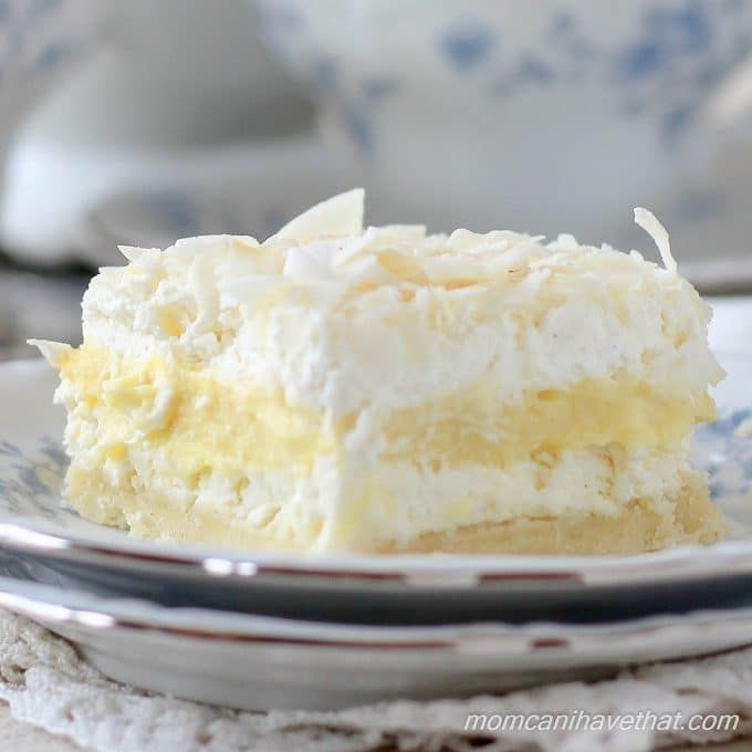 Low carb coconut cream layered dessert (Coconut Cream Delight) is a pie in bar form: a cookie crust, cream cheese, coconut pudding, whipped cream & coconut.