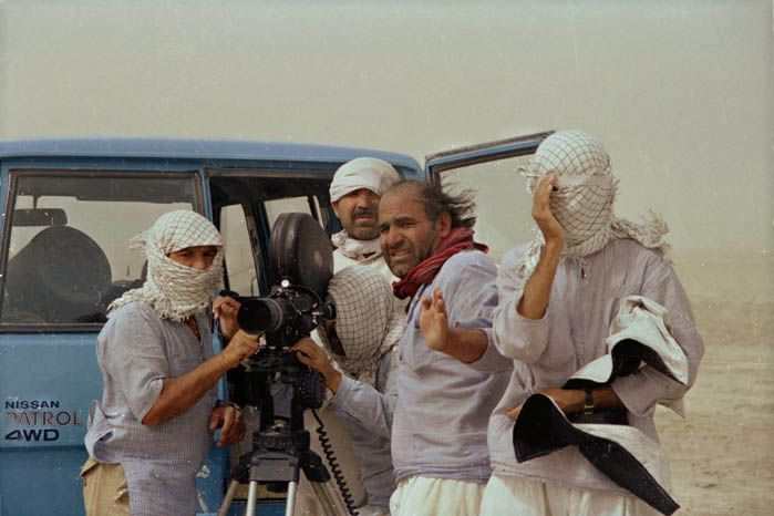 """. The Runner and other films Naderi made in the 1980s helped develop and promote some of the visual and narrative strategies that would also appear in the works of other Iranian art-house film directors. However, these films already hinted and anticipated the director's desire to leave Iran; Hamid Naficy called them """"proto-exilic"""" films.[4] By the 1990s, Naderi emigrated to the United States"""