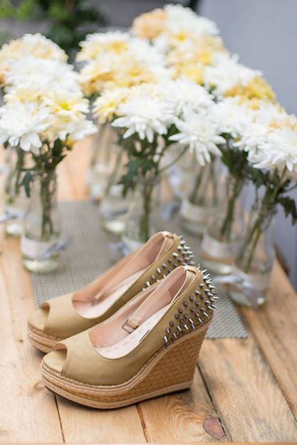 My wedding shoe! Love it! That shoe cost me only RM 70 (USD 22). Actually, I buy the shoe for my bestfriend wedding and I am the maid of honor. I love the spike and the color. So why not recycle? I'm not a big fan of heels or wedges etc, only on special occasion.  As you can see, The flowers are for the dining table. I use white and orange pom poms and randomly arrange them in a recycle glass bottle.  I got the glass bottle from my friend's cafe with zero payment.  Cost : RM 50 (USD 15)