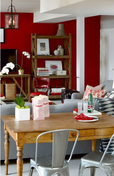 Deep Red Family Room Walls With Stairs
