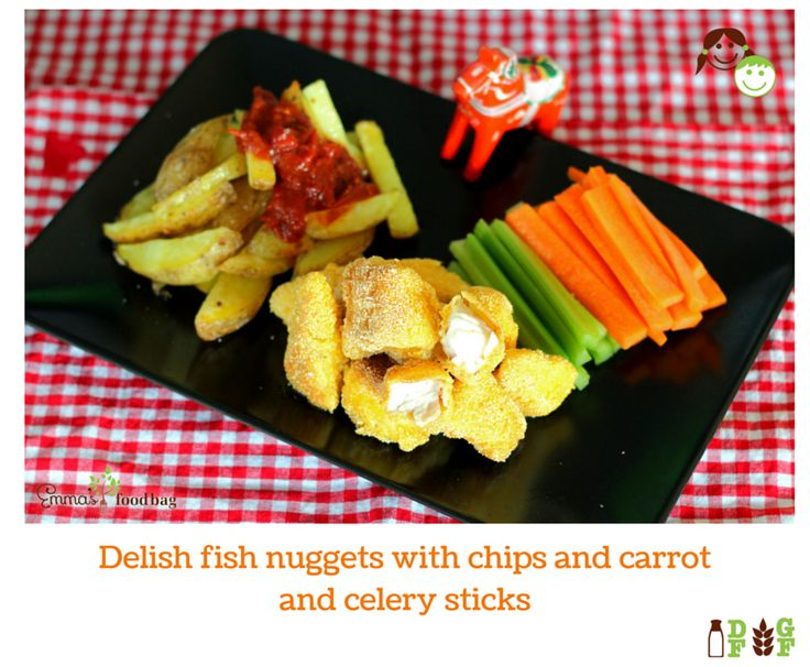 Delish fish nuggets with chips and carrot and celery sticks