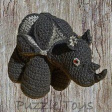For the kids, this unusual crochet rhino ... lovely design and a great toy!  Available from www.ietsienice.co.za!