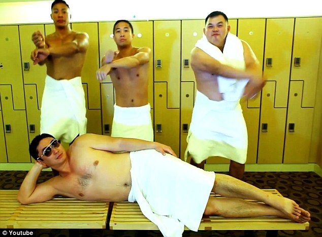 Shades of Psy: The groom and ushers are seen throwing shapes in a locker room while wearing towels - another scene from the Gangnam Style music video