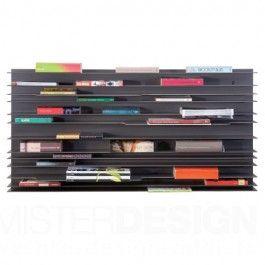 De Spectrum Paperback Boekenkast is een wandkast, ontworpen door Studio Parade in 2009. De kracht van het ontwerp is dat het minimale ruimte inneemt in een interieur en tegelijkertijd een opvallende verschijningsvorm heeft. De dunne legplanken leveren een bijzonder lijnenspel. De paperback krijgt door de invulling van boeken, cd's en kleine glas of keramiek voorwerpen een eigen grafiek en palet aan kleuren.  Paperback is modulair en bestaat per set uit één stevige wandplaat van 60 x 120 cm…