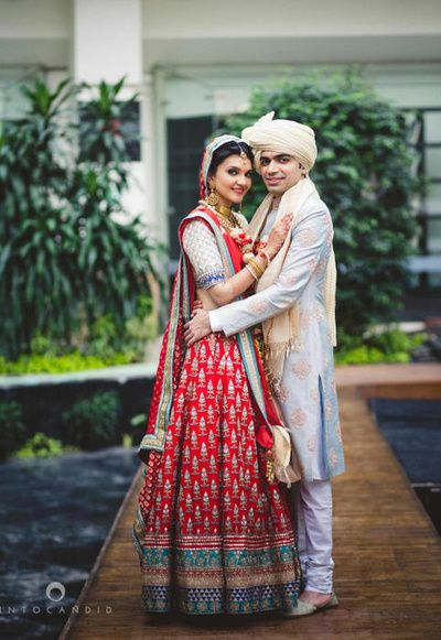 red and blue bridal lehenga by Anita Dongre summer bride 2015, red and white , color coordinating bride and groom, traditional, gota patti, blue border