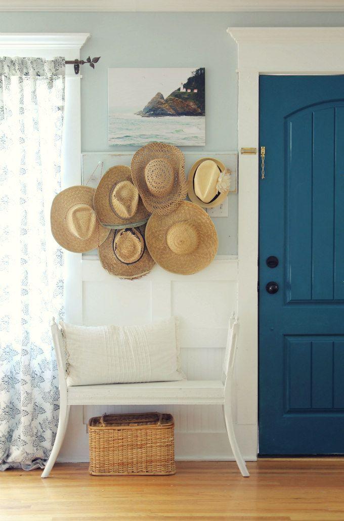 Cottage home tour - love the collection of hats eclecticallyvintage.com