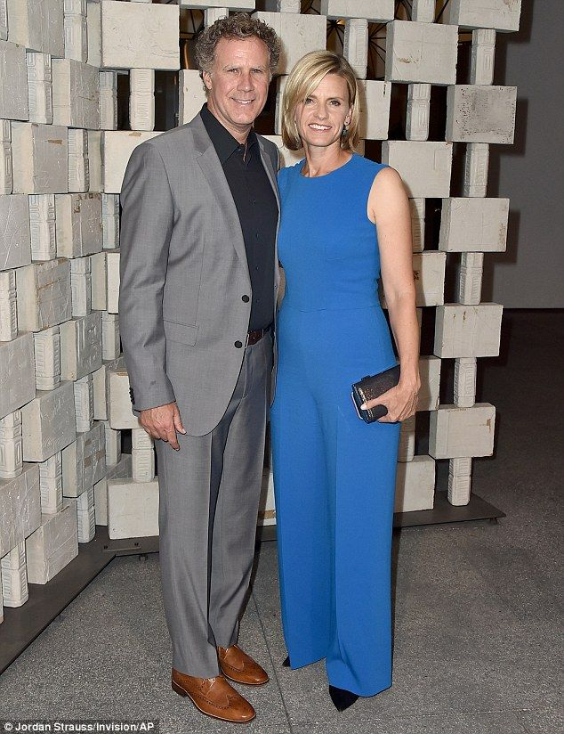 Happy faces: Will Ferrell smiled as he posed with his wife Viveca Paulin...