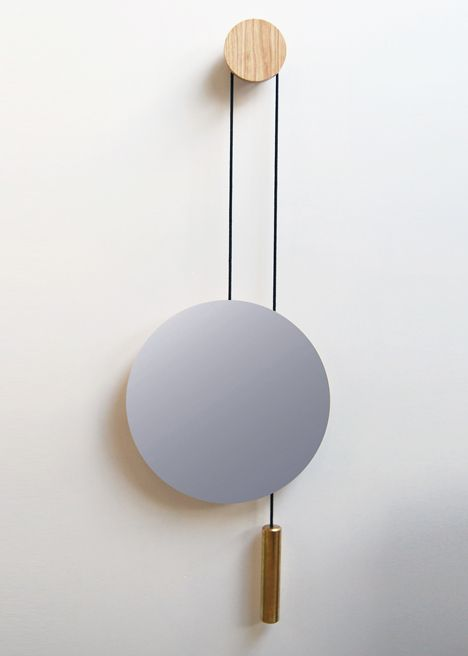 London Design Festival 2013 Roundup — THE OPSIS: A large brass weight counterbalances this circular mirror by London design studio Hunting Narud. Hunting Narud's Rise Shine features a circular smoked-glass mirror attached to a rope that wraps around a small birch wood disc fixed to the wall.