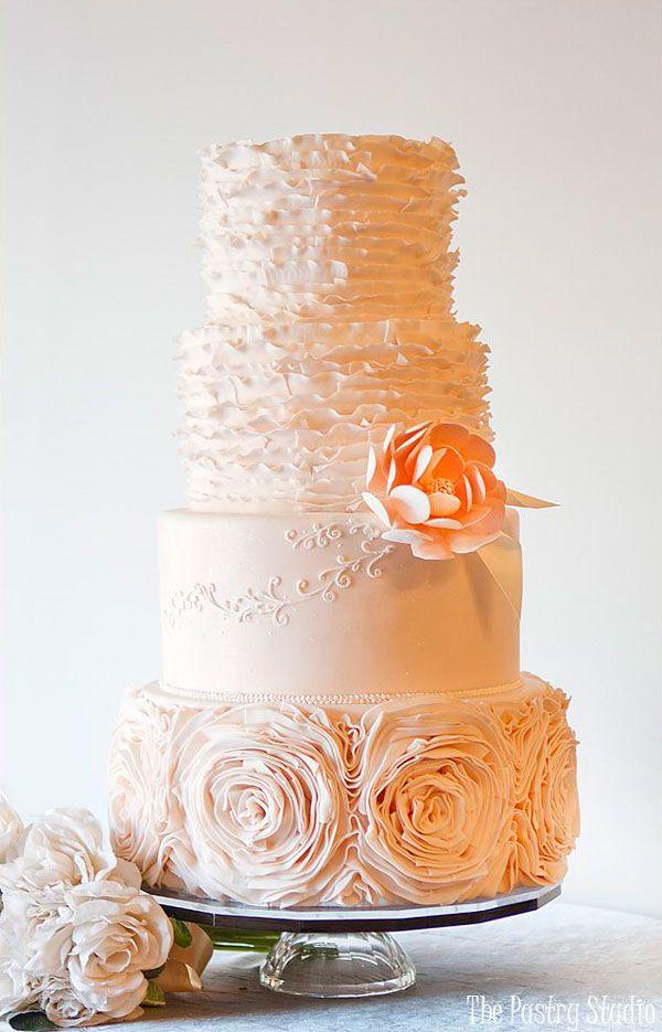 wedding cakes in lagunbeach ca%0A blush ruffled wedding cake with bottom layer of ruffled flowers