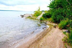 1.4 acre lot in 18,000 acres LaCloche park 295' on lake Huron