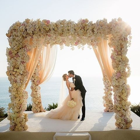 Imagine a pretty pastel wedding day in #California  on the seaside bluffs of #DanaPoint. A fairytale dream  with over the top floral and a knock out bride. : @linandjirsa | Coordinator, Design & Production: @whitelil