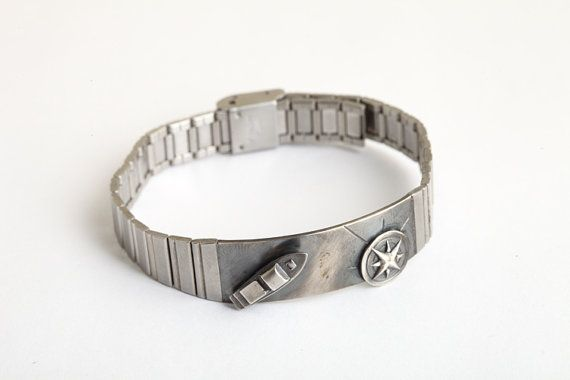 """Part of my new """"Hipster"""" collection, this unique handmade bracelet is designed to tell a story, this one of adventures on the high seas sure to please the nautical lover in your life. This link style bracelet is made of Stainless Steel , with a faceplate from 925 sterling silver that features a 3D boat and compass rose, both pieces I have engraved by hand with immense attention to detail. The oxidized finish manages to give this contemporary piece an old-world feel. Comes in S, M, L and XL…"""
