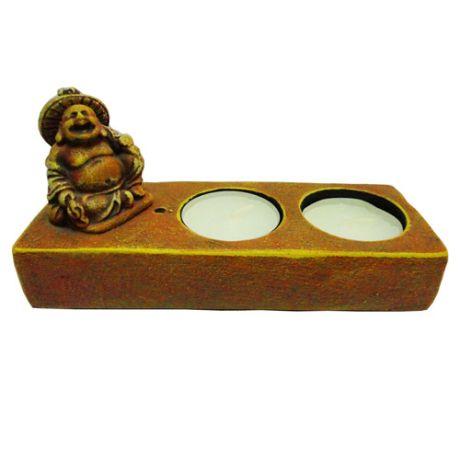http://www.maniasemanias.com/produto/suporte-para-2-velas-com-buda - SUPORTE PARA 2 VELAS COM BUDA - Suporte para duas velas tealight e um incenso, com buda. - Material: pedra pó - Dimensões: 14,5 x 6 cm