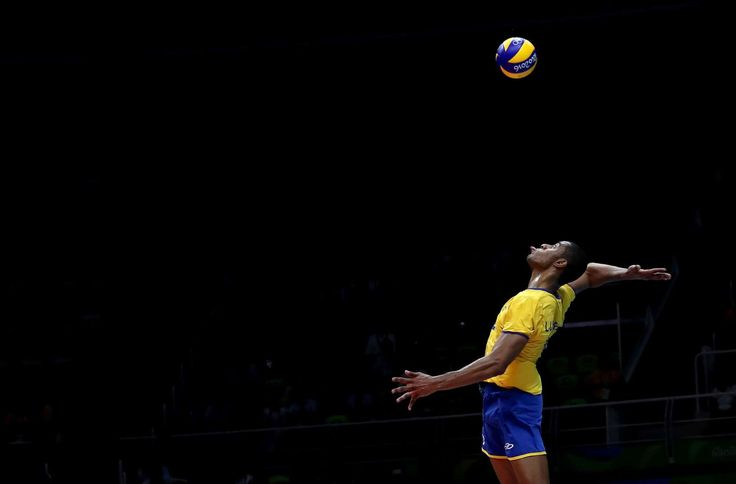 Spiked:     Ricardo Lucarelli of Brazil spikes the ball during the men's qualifying volleyball match between Brazil and France on Aug. 15.