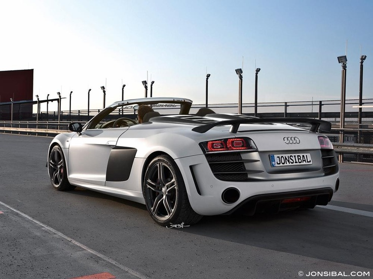 Check out this beautiful Silver R8 Audi Spyder. Wow! Drop the top, turn on your favorite music and let everything fade into the background!