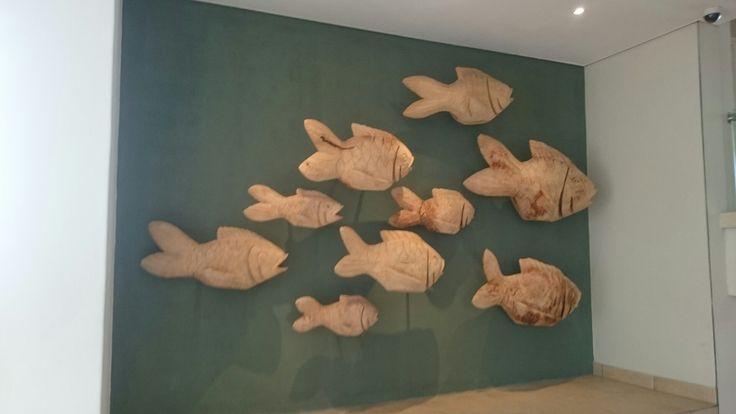 Wooden Fish Sculpture at Breakers Resort entrance