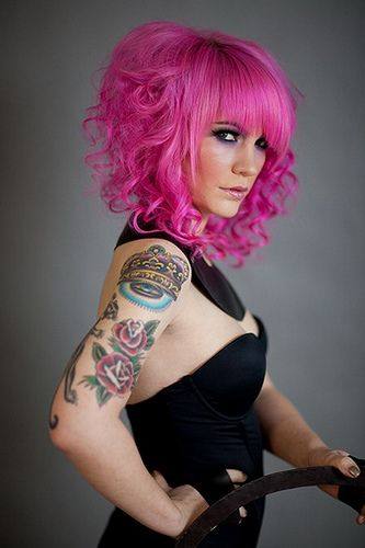 love her hair style and pink looks good on her.
