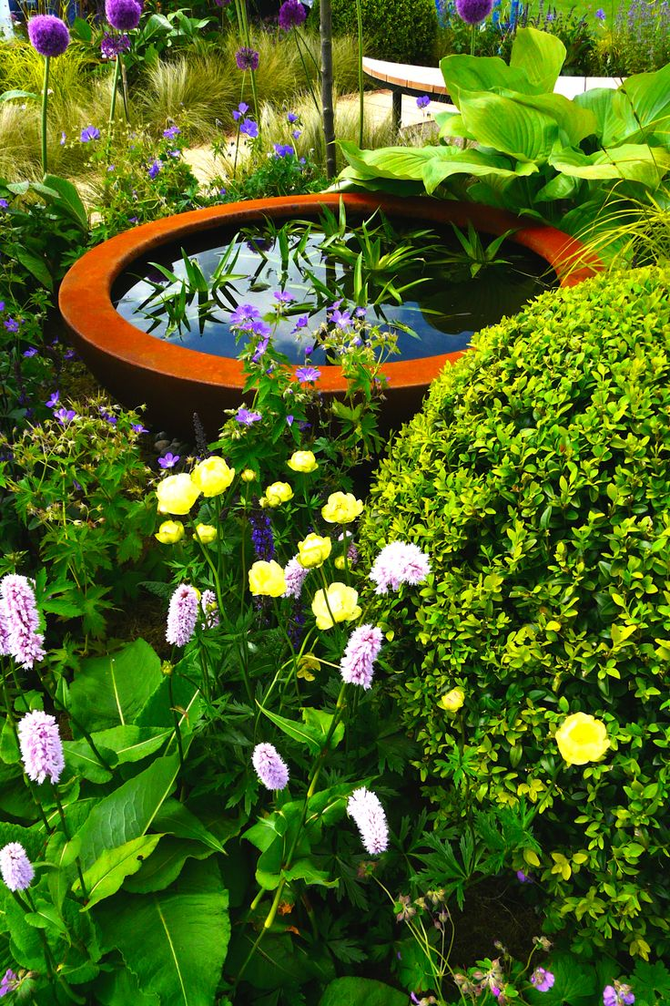 Designed by Carolyn Grohmann. Urbis Design lily bowl with planting.
