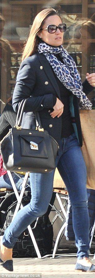 The brunette chose a £475 tote bag by Milli Millu, flat suede pumps and a leopard print sc...