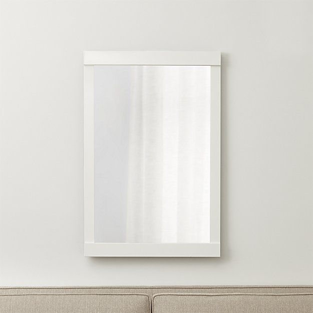 Shop Colby Soft Gold Wall Mirror. Overlapping frame ends lend an architectural air to this clean-lined aluminum finished in soft gold.