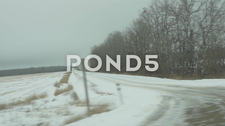 Slow Motion Driving By Fields Of Snow Trees Road Farm Hand Held - Stock Footage | by RyanJonesFilms