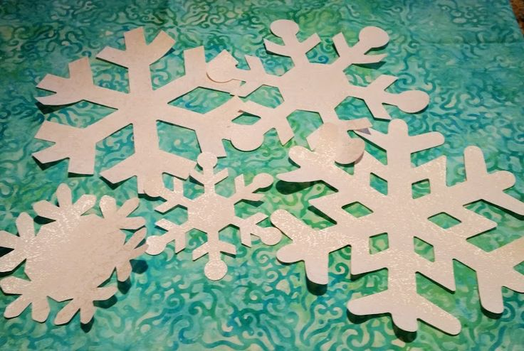 """12- 7"""" pre-fused snowflakes with 3 bonus 4"""" snowflakesPerfect for holiday or Frozen quilts Fabric is Clothworks White Pearle, from 5bucksayard.com"""