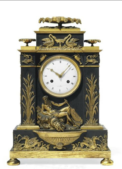 A DIRECTOIRE ORMOLU AND PATINATED BRONZE STRIKING MANTEL CLOCK LATE 18TH CENTURY