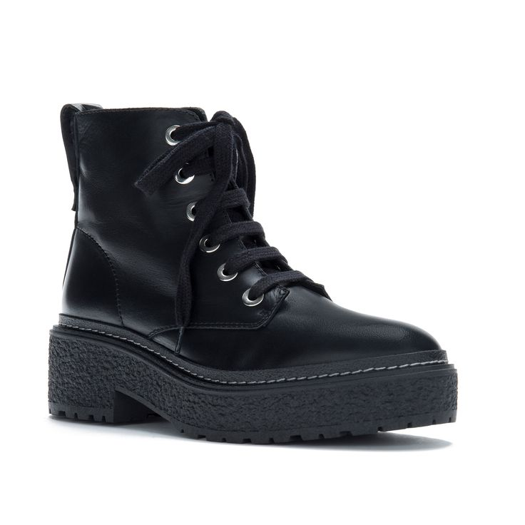 BIMBA Y LOLA leather boot with laces. From the Drag Racer Collection, with details inspired by motor cars such as padded fabrics, vibrant leathers and metallic embellishments.  Model with rounded toe and rubber block platform with irregular, crepe-style t