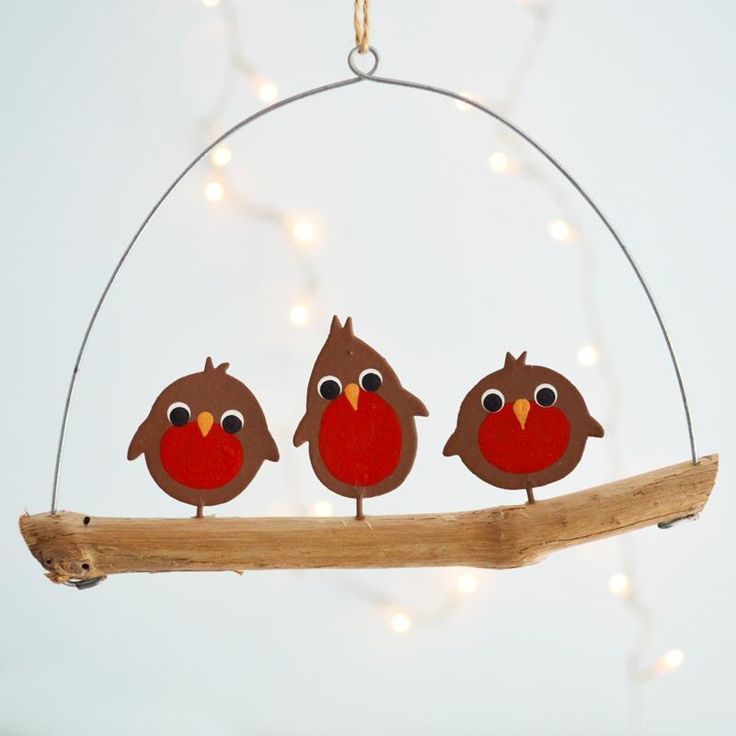 Three very cute metal Robins sitting on a driftwood hanger available from www.coastalhome.co.uk