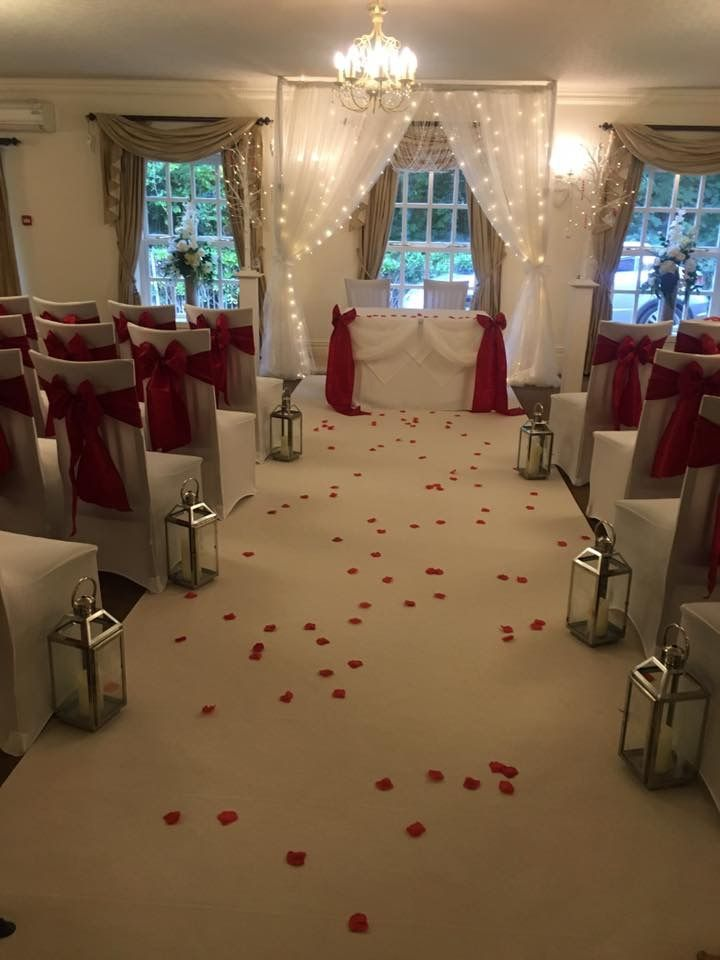 Red Christmas wedding ,backdrop and isle carpet #lythamwedding #lythamevents #lythamchristmas #lancashireweddings #lancashireevents www.thelythamweddingcompany.co.uk