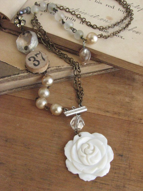 I love the look of this necklace! Sparkly and shabby chicness! Long Shabby Chic Rose Necklace -repurposed assemblage of pearls and game piece-. $38.50, via Etsy.