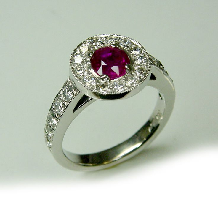 Hand made 18ct gold Halo ring with a natural Ruby center.