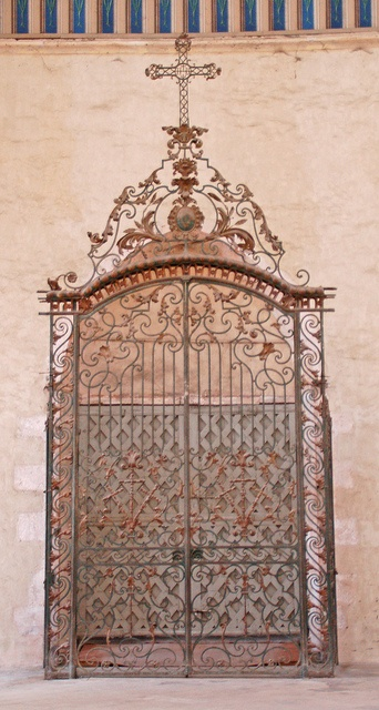 Ornate wrought iron gate inside the central doors - Église St. Quiriace, Provins