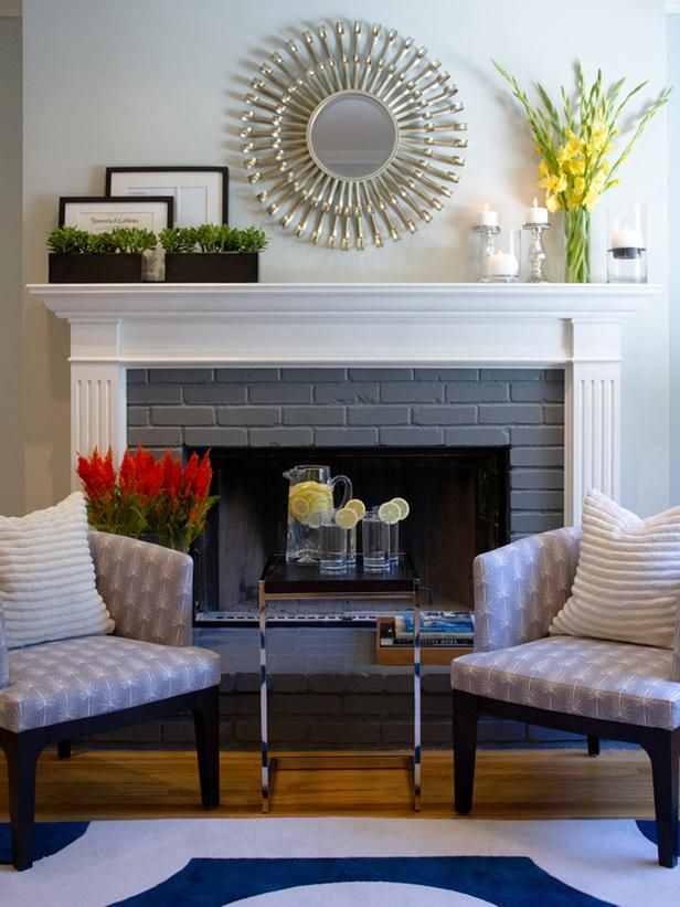 Mirror above the fireplace. So pretty! www.hgtv.com/living-rooms/20-mantel-and-bookshelf-decorating-tips/pictures/page-13.html?soc=pinterest