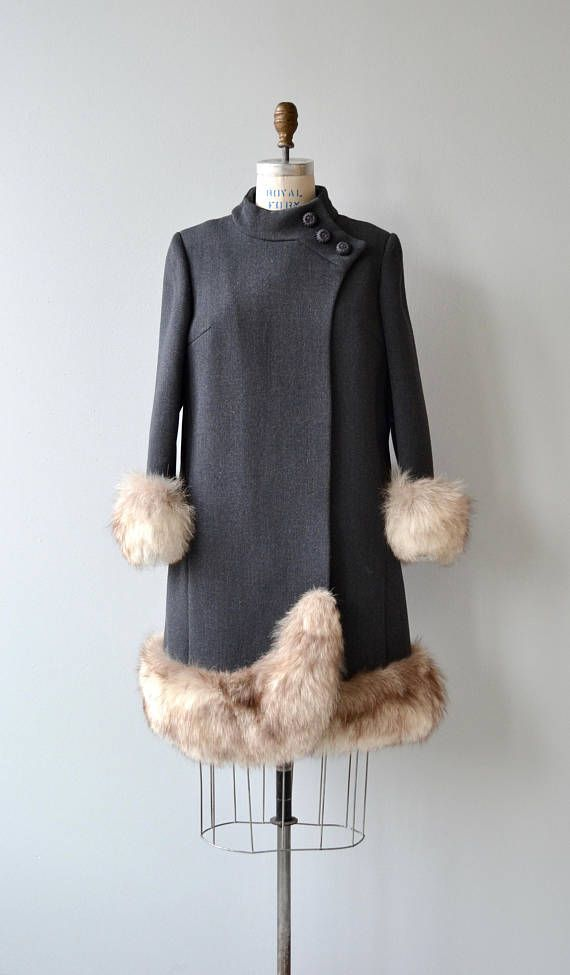 Vintage 1960s charcoal grey wool coat with small funnel neck collar, wide fox fur cuff & hem, crochet buttons at one shoulder and mulberry satin lining. A heavy coat that is appropriate for cold winter weather.  --- M E A S U R E M E N T S ---  fits like: small/medium shoulder: 17 bust: 34-38 waist: up to 36 hip: 44 sleeve: 22 length: 37 brand/maker: Mirrows condition: excellent  ★ layaway is available for this item  ➸ More vintage coats http://www.etsy.com/shop&#...