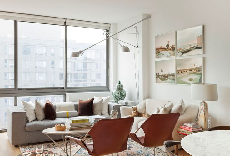 LIVING/DINING ROOM  • Sofas: Cappellini, Cassina • Sconces: Flos • Coffee table: Oly Studio • Lounge and dining chairs: Design Within Reach • Side tables: Moroso • Media cabinet: Mash Studios • Dining table: Room and Board • Credenza: Kartell • Rugs: Overstock, Cowhides International