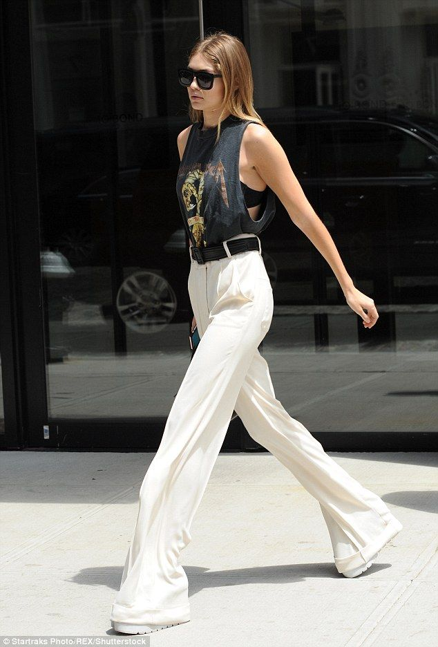 In her stride: The model's flaring trousers fluttered with every movement while the gapin...