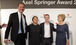 Mathias Döpfner (L) chair of Axel Springer with Priscilla and Mark Zuckerberg and publisher Friede Springer.