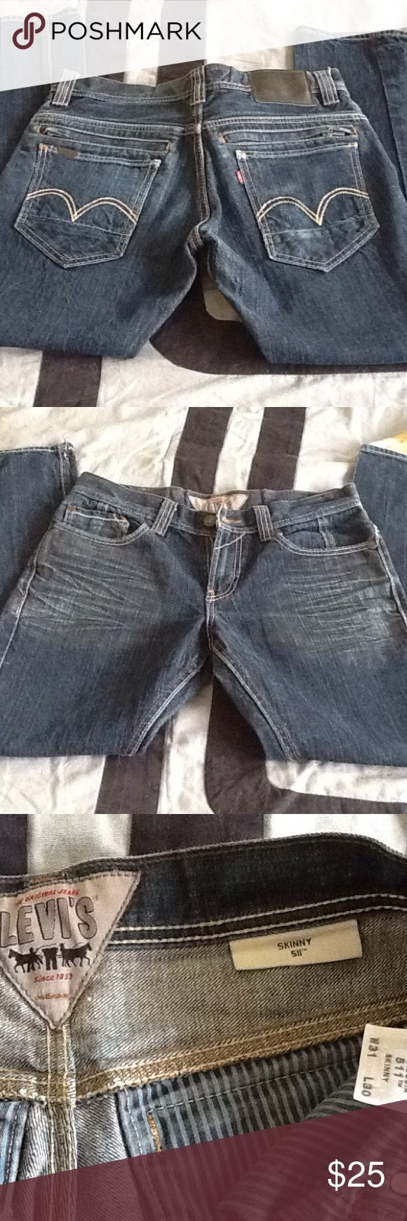 Men's Levis 511 skinny Like new pair of men's dark denim skinny jeans with engineered creasing below front pockets and behind lower thighs/knees.  Extra back zip pockets--see pic.  31x30 Levi's Jeans Skinny