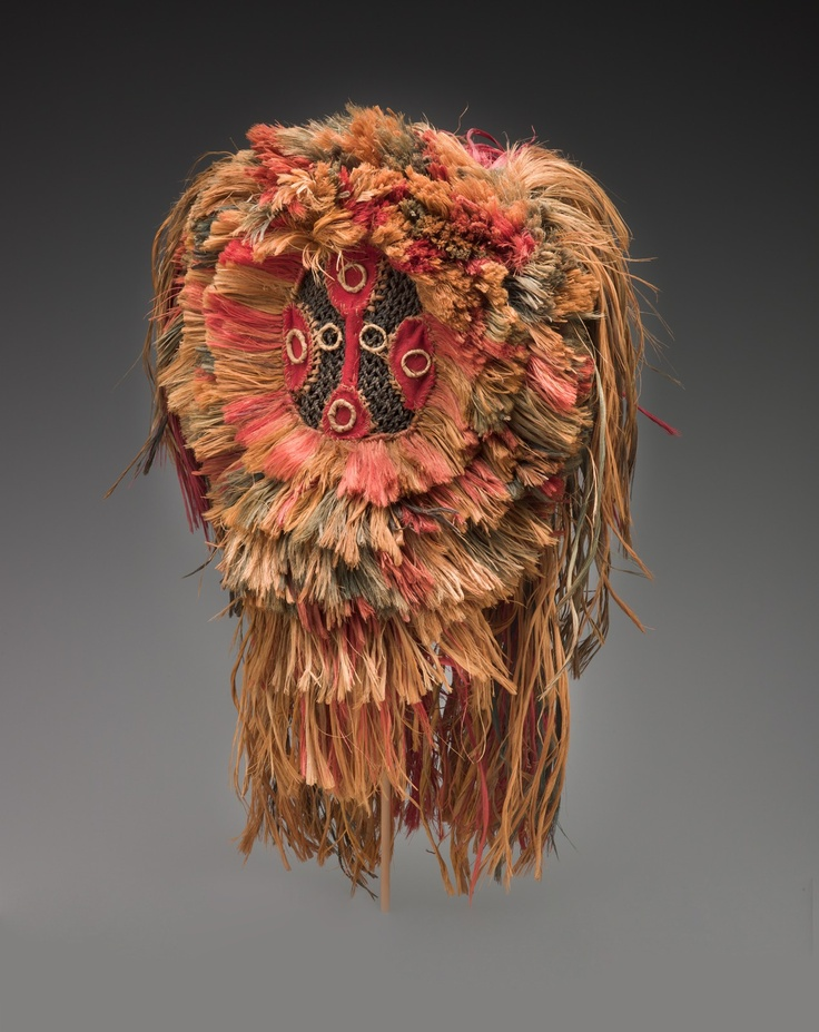 Africa | Helmet Mask. Maninka people.  20th century.  Fiber | Masks of fiber, cloth, feathers, leather, and other non-wood construction are widespread in sub-Saharan Africa, but because of ethnocentric relegation to the category of minor or craft-oriented forms, they have often been neglected by collectors as well as researchers. This example, consisting largely of dyed and natural fibers, may represent a lion and was used by a youth association.