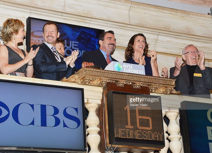 CBS's 'Blue Bloods' cast members Amy Carlson, Donnie Wahlberg, Will Estes, Tom Selleck, Bridget Moynahan and Len Cariou visit the New York Stock Exchange on May 16, 2012 in New York City.