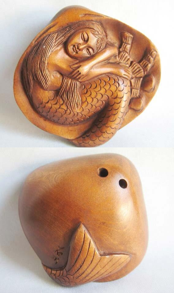 mermaid netsuke I believe these to be Japanese and have seen them on UK Antiques roadshow. They tie up kiminos.
