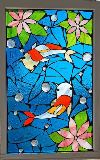 interesting blend of stained glass and mosaic window..pretty!