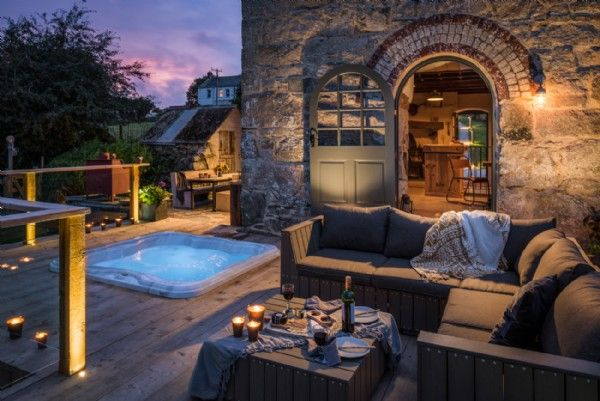 The deck leads off the kitchen and includes a luxurious sunken hot tub